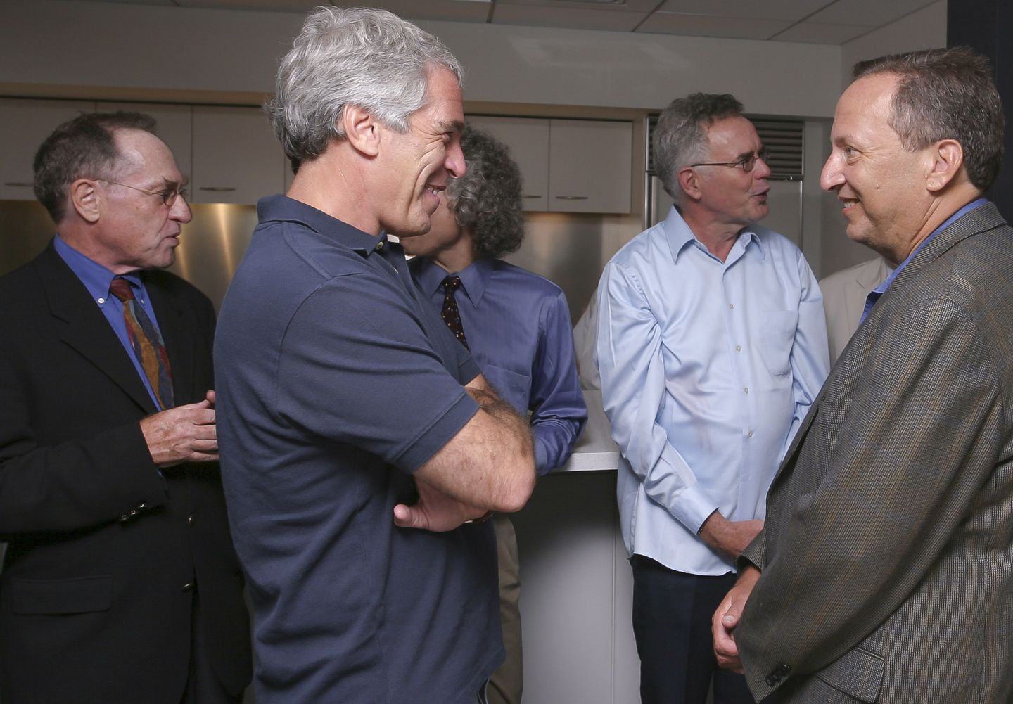 Jeffrey Epstein (second from left) hosted a dinner at Harvard in 2004. With him were (from left) Alan Dershowitz, Robert Trivers, and Lawrence Summers.