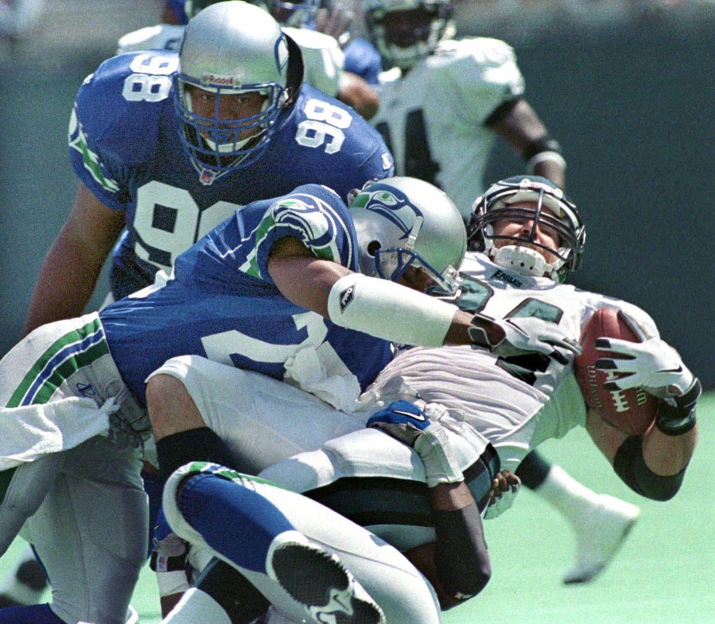 Kevin Turner takes a hit during his days with the Eagles, in a game against the Seattle Seahawks.