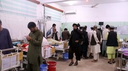 Injured victims of the bomb blast during congregational prayers at Shi'ite Muslims Mosque received treatment at a hospital in Kandahar, Afghanistan, on Oct. 15, 2021.