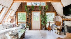 A view of the living room in an A-frame home located in Stowe, Vermont.
