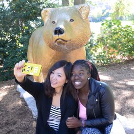 At Western New England University in Springfield, Emi Nanasawa of Tokyo and Shallom Adewale of Lynn snapped a selfie by the Golden Bear mascot.