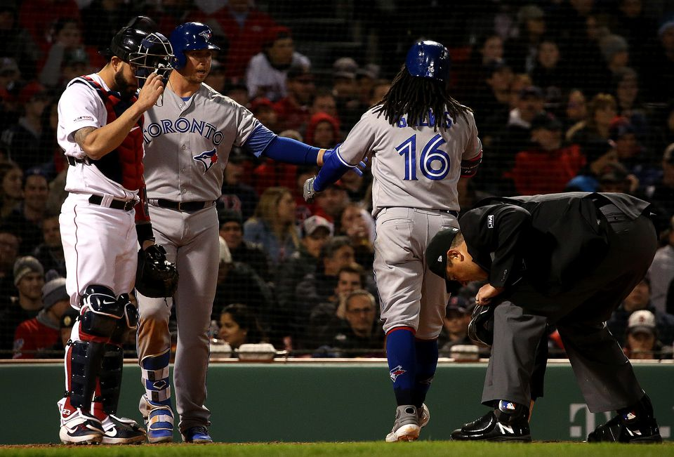 Blue Jays shortstop Freddy Galvis (16) is congratulated at home after his solo home run gave the Jays a 6-5 lead in the eighth inning.