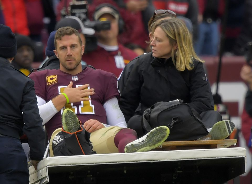 Redskins quarterback Alex Smith gets carted off the field after breaking his right leg on Nov. 18.
