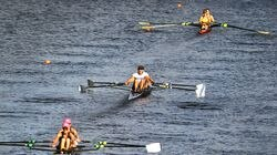 Rowers in the women's grand master doubles made their way along the river Friday morning.
