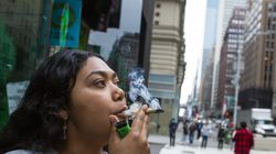 Eliana Miss Illi, general manager of Weed World, smokes a joint on 7th Avenue in Midtown Manhattan.