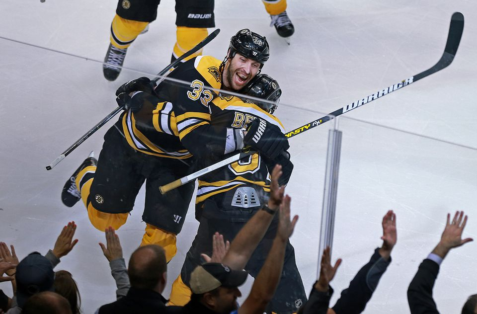 Patrice Bergeron and Zdeno Chara celebrated after Bergeron's goal in OT eliminated the Maple Leafs in 2013.