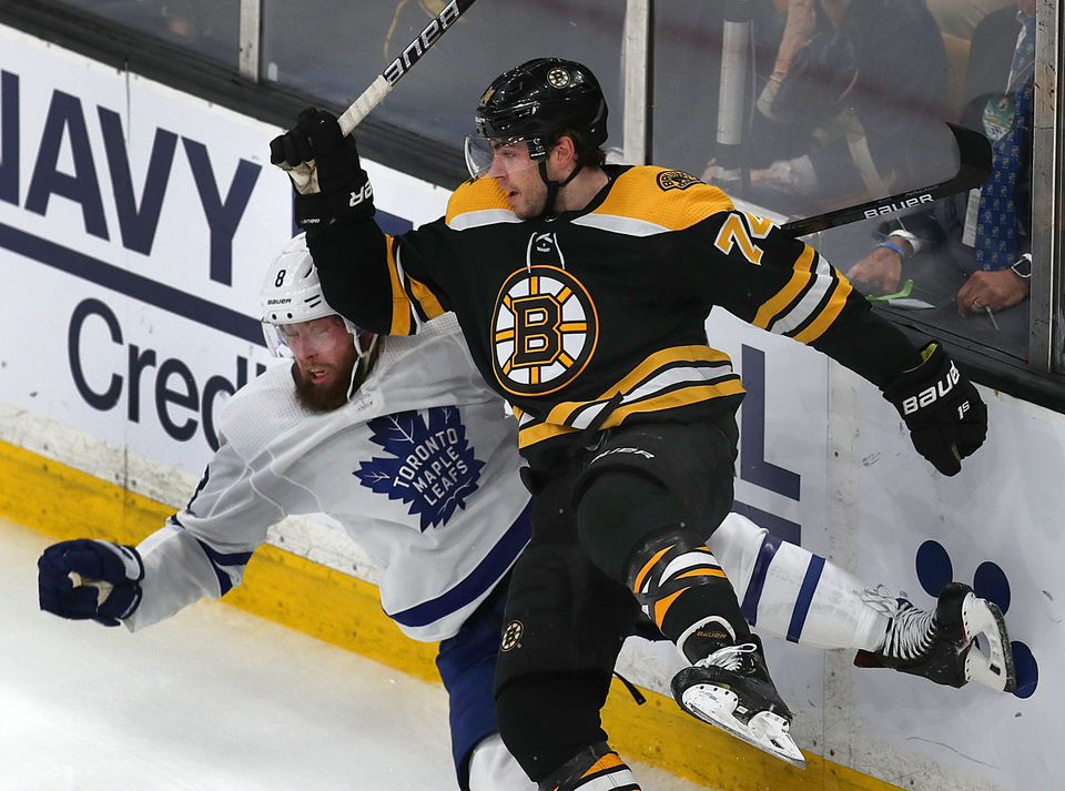Bruins winger Jake DeBrusk collided with Maple Leafs defenseman Jake Muzzin along the boards.