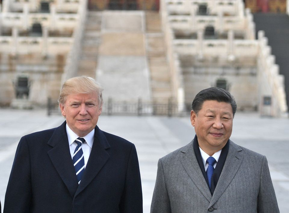 US President Trump (left), and Chinese President Xi Jinping (right) pose at the Forbidden City in Beijing.