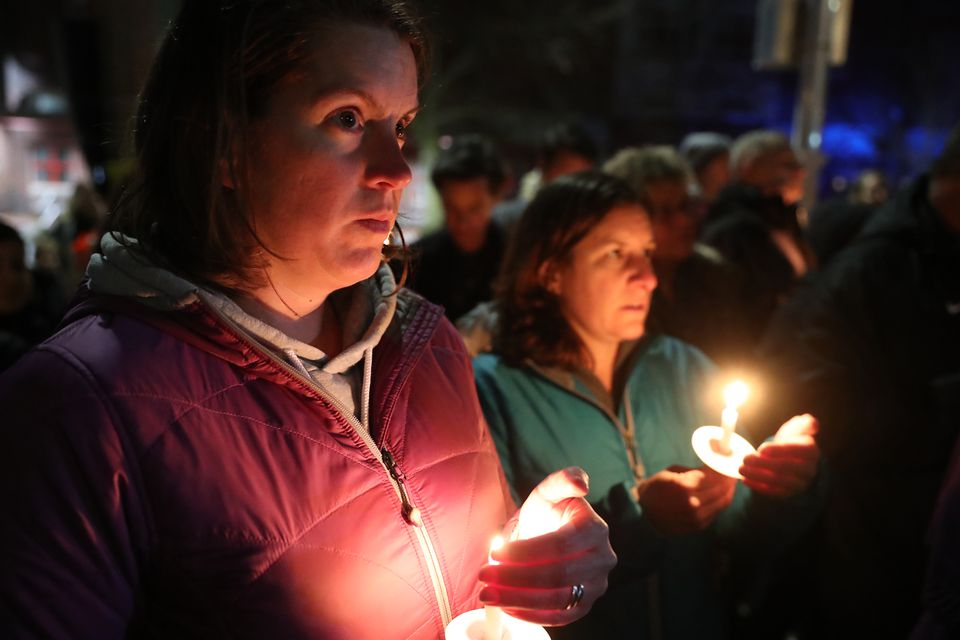 Shani Leichter and Christine Carlettei held candles at Friday's vigil.