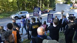 """Stagehands and supporters formed a picket line outside North Shore Music Theatre Wednesday hours before the opening performance of """"Mamma Mia!,"""" which was eventually canceled. The two sides came to an agreement Thursday."""