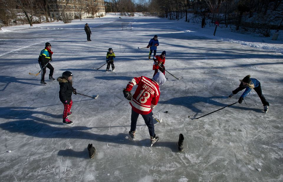 One  day, this scene could be only a memory for Canadians and New Englanders: People playing hockey in Ottawa's Central Park, on Christmas Day, 2018.