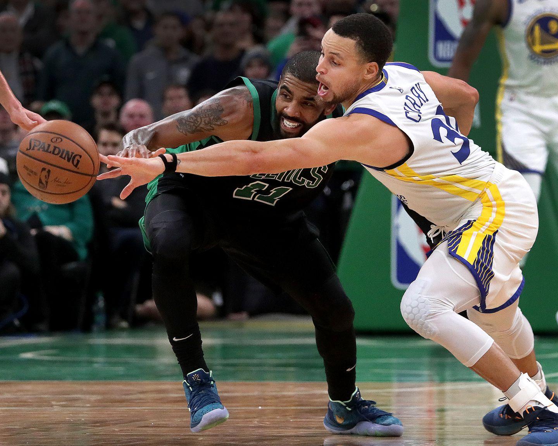 a1da93cbf40d Celtics guard Kyrie Irving (11) loses the ball as Golden State Warriors  guard Stephen