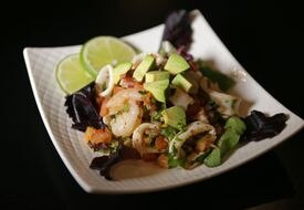The salads include shrimp and calamari ceviche, topped with avocado.