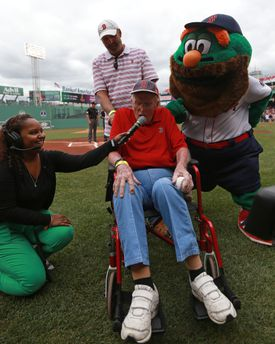 "Sox fan Allan Munroe, 87, yells out ""Play Ball"" at Fenway on Saturday."