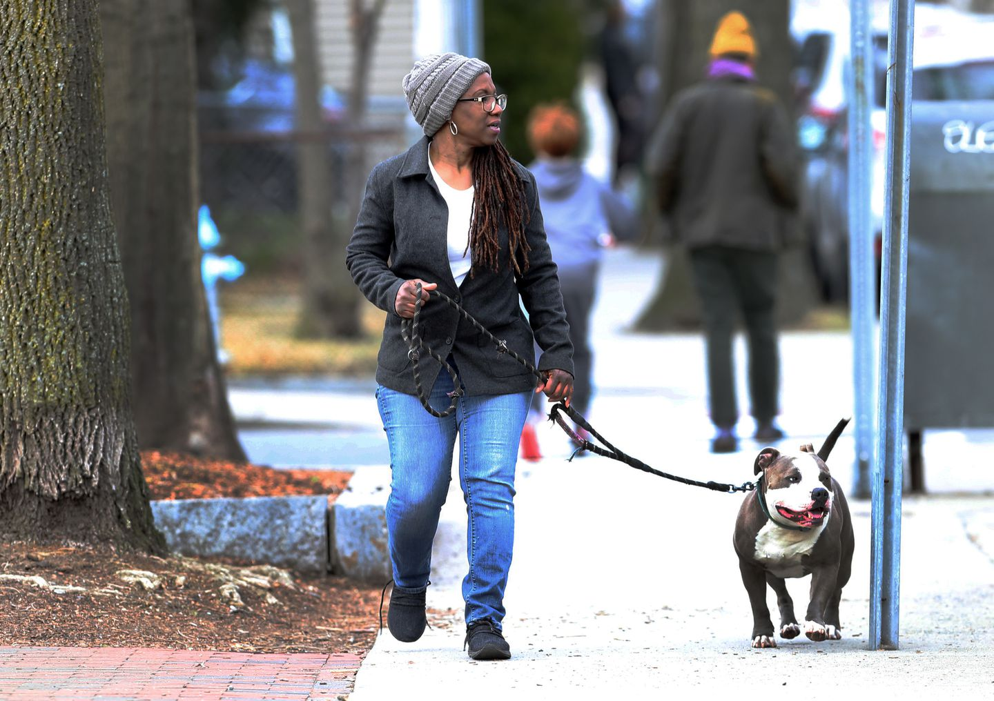 Cynthia Haynes, of Cambridge, looks for social distancing scofflaws while out on walks with her dog. She has posted comments on social media and filed complaints with police about people who aren't following health guidelines. Haynes worries about the well-being of residents most vulnerable to the virus, including her mother, who's in her 80s.
