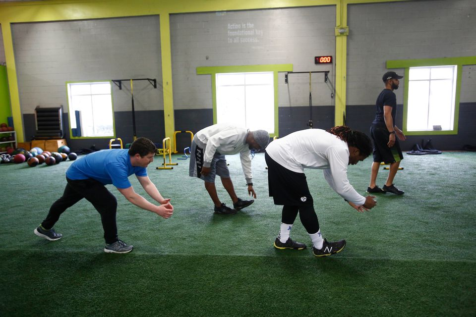 The Globe's Ben Volin (blue shirt, undersized backup) was a full participant with some NFL players during a workout at Athlete By Design in Charlotte, N.C.