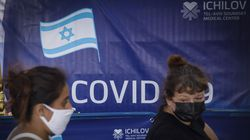 Foreign nationals depart a vaccination center in Tel Aviv, Israel, on Wednesday, Feb. 10, 2021. Israel, with the highest proportion of citizens vaccinated against Covid-19 in the world, found it took three weeks for the Pfizer-BioNTech shot to start curbing new cases and hospitalizations.