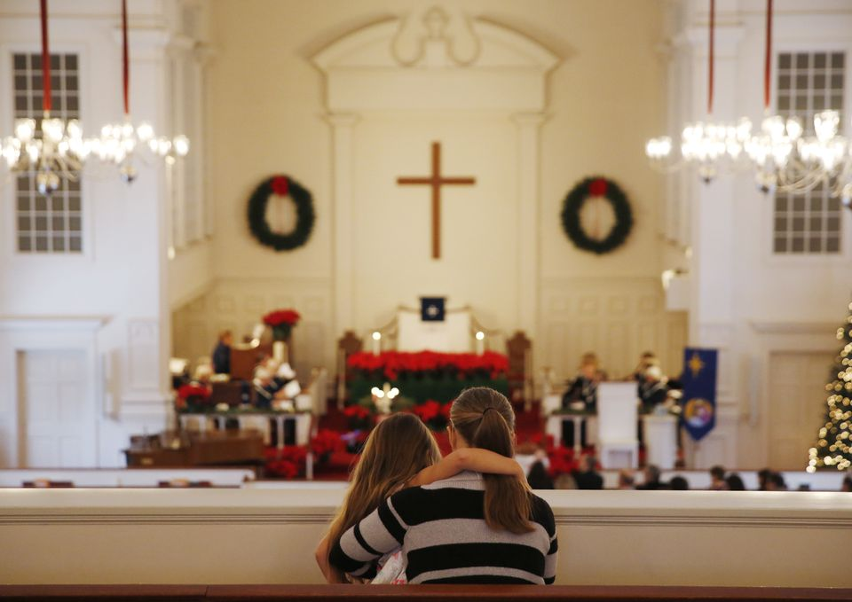 Amy Moore and her daughter, Samantha, 6, sat in the balcony for a service at The Plymouth Church in Framingham.