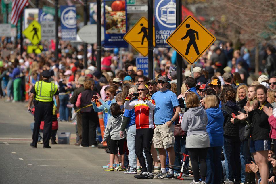 Spectators in Natick cheered on runners during the 2014 Marathon.