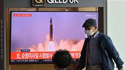 People watched a television news broadcast showing file footage of a North Korean missile test at a railway station in Seoul on Sept. 15, after North Korea fired two ballistic missiles into the sea according to the South's military.