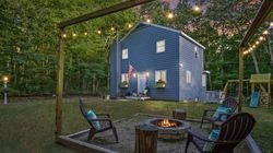 The yard with a firepit at 80 Bogan Avenue, Lancaster.