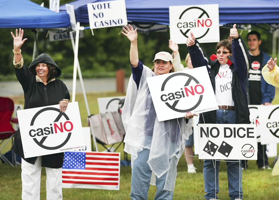 A nonbinding referendum vote on the Aquinnah tribe's casino proposal brought opponents out in the rain to the George Austin Intermediate School on Saturday.