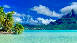 Mount Otemanu stands over the palm trees and clear water in Bora Bora, which ranked number 3 on the list of World's Best Places to Visit.