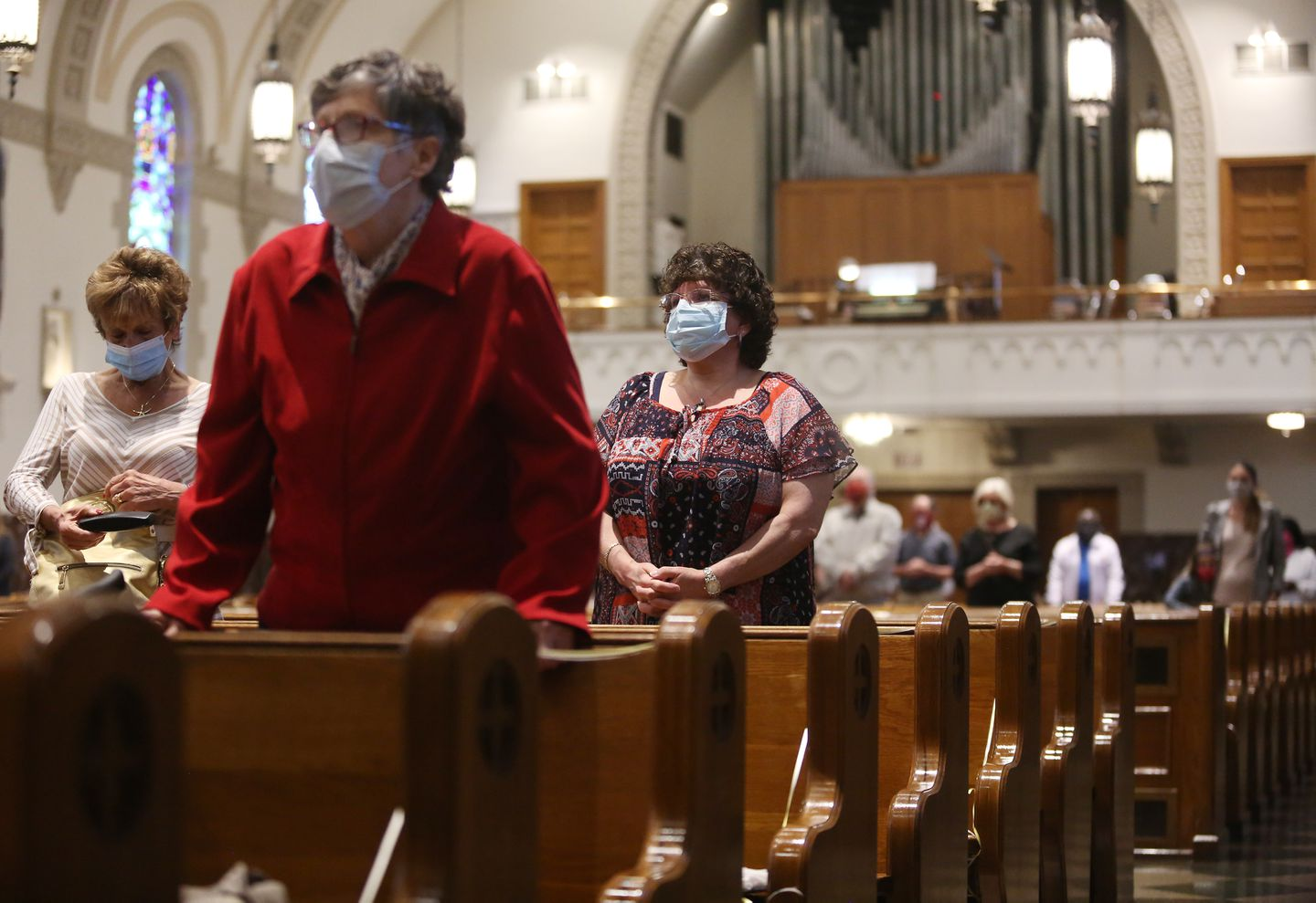Churches plot cautious course after Baker allows reopening - The ...