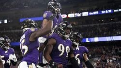 Odafe Oweh (center) secured Kansas City's second turnover of the game Sunday night, recovering Clyde Edwards-Helaire's fumble late in the fourth quarter and ensuring Baltimore beat the defending AFC champions.