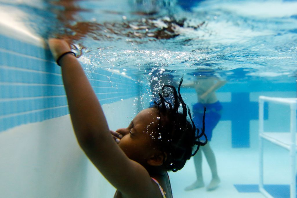 A child holds her breath underwater while participating in a swimming class in this 2014 file photo. JESSICA RINALDI/GLOBE STAFF