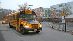 School buses left after dropping students off at the Mattahunt elementary school in Mattapan in mid-December.
