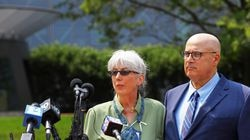 Ina and David Steiner talk to the media behind the John Joseph Moakley United States Courthouse in Boston. They filed a civil suit against eBay and its top executives.
