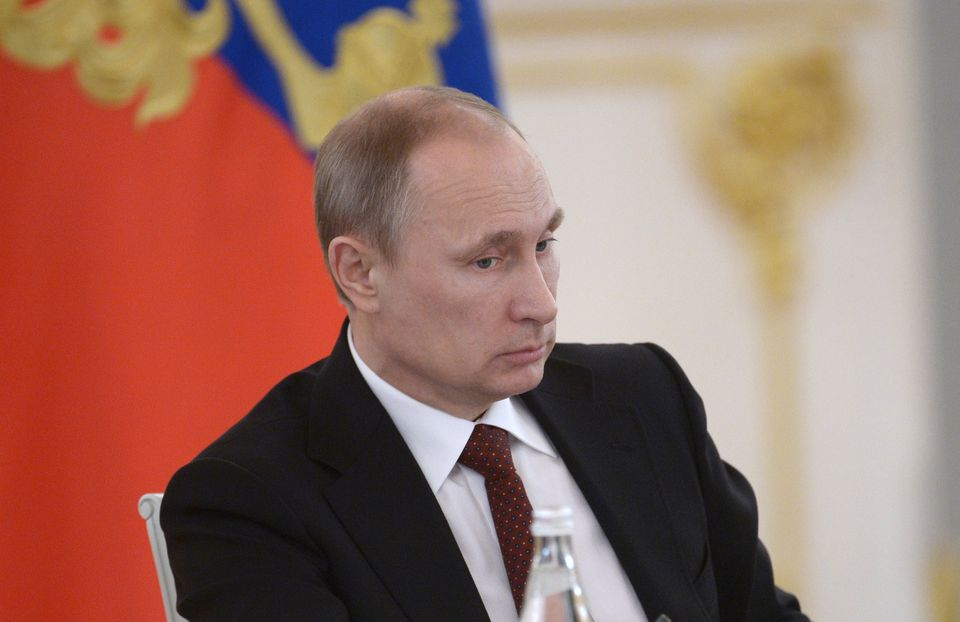 Russian President Vladimir Putin chairs a government meeting at the Kremlin in Moscow Monday.