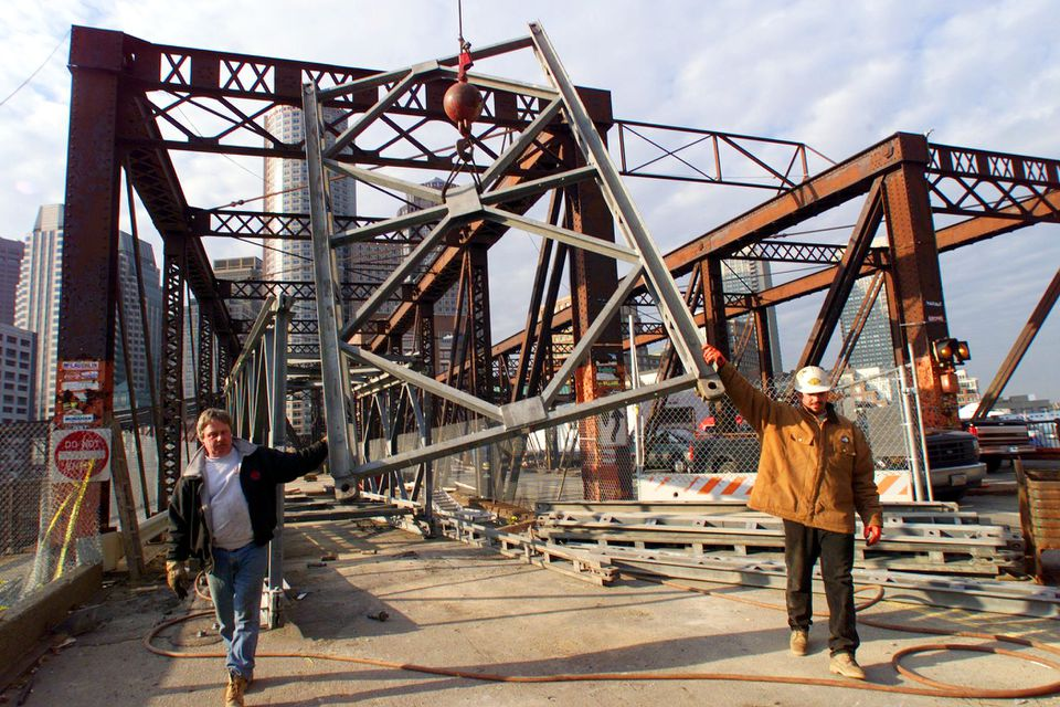 Workers removed a section of a steel pedestrian walkway that spanned the old Northern Avenue Bridge, after the Coast Guard ordered the pedestrian walkway removed.