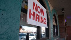 """A """"Now Hiring"""" sign outside a restaurant in Huntington Park, Calif."""