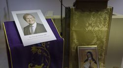 A photograph of Sir David Amess was displayed during a vigil held at Saint Peter's Catholic Church, following the stabbing of UK Conservative MP Sir David Amess as he met with constituents at a constituency surgery on Thursday in Leigh-on-Sea, England.