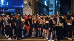 People waited to pass through security measures to enter a popular bar in Nottingham, England, last week.