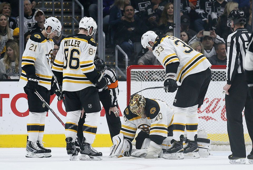 Goalie Tuukka Rask was slow to get up as (from left) Loui Eriksson, Kevan Miller, and Zdeno Chara waited to provide assistance.