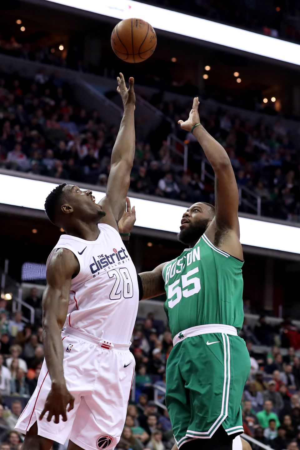 Greg Monroe, the Celtics' latest addition, puts up a shot over Washington's Ian Mahinmi.