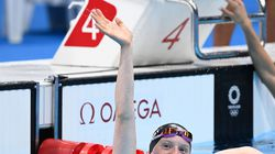 Lydia Jacoby of Seward, Alaska, celebrates after winning the women's 100m breaststroke early Tuesday at the Tokyo Aquatics Centre.