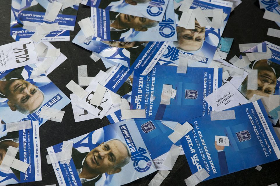 Likud party ballot papers and Israel's Prime Minister Benjamin Netanyahu's campaign fliers are seen on the ground after polls for Israel's general elections closed in Tel Aviv.