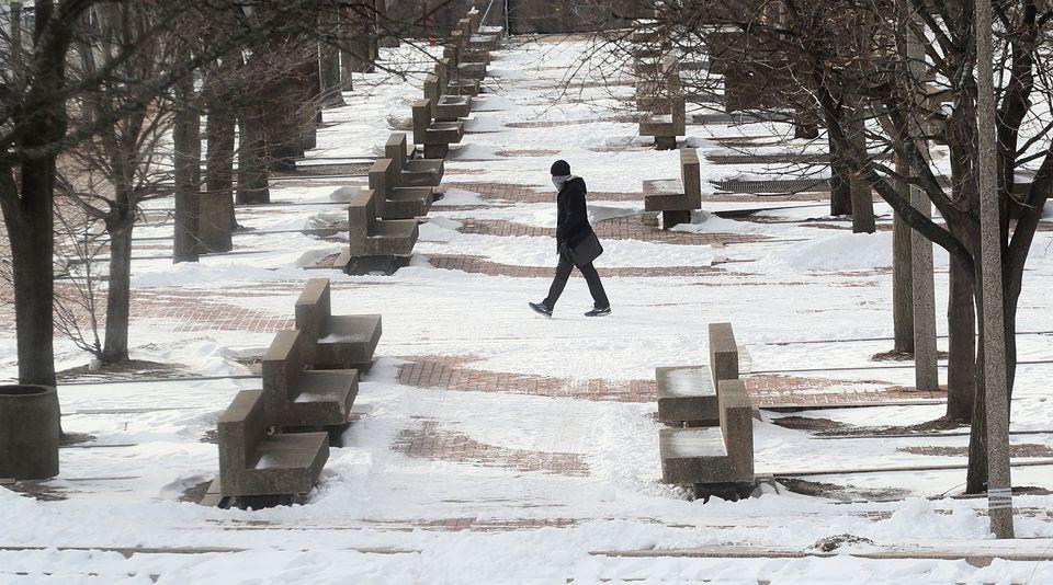 A man walked across City Hall Plaza last week.