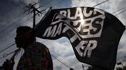 A demonstrator carried a Black Lives Matter flag before a march in Texas. A new study of diversity in the technology industry found companies that made statements of solidarity with the Black Lives Matter movement had 20 percent fewer Black employees on average than those that didn't.