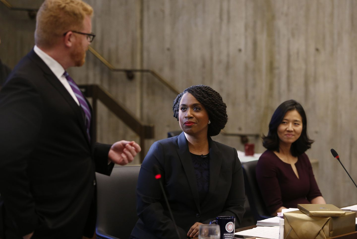 Congresswoman-elect Ayanna Pressley listened as City Councilor Matt O'Malley wished her farewell at City Hall.