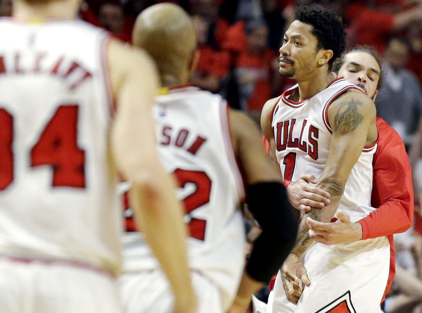 cda8f2381556 Bulls guard Derrick Rose (1) was mobbed by his teammates after hitting the  winning