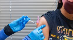 A healthcare worker administers a dose of the Pfizer-BioNTech COVID-19 vaccine in Missouri.