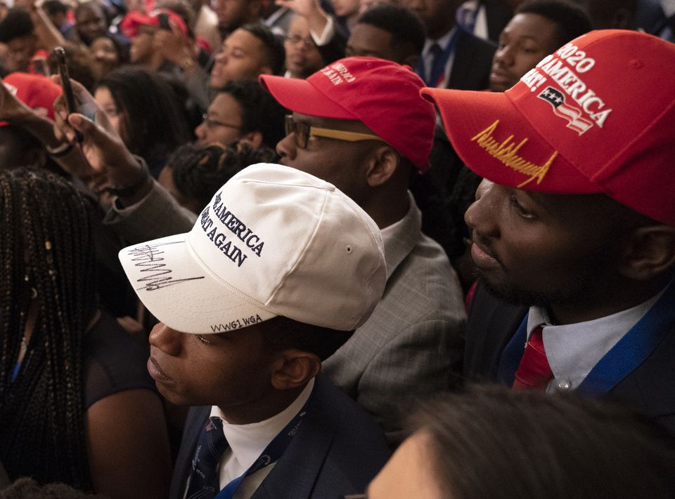 Attendees listen to President Trump's address during the 2018 Young Black Leadership Summit at the White House on Oct. 26, 2018.