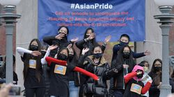 """Phoebe Tian, 14, of Lexington, in front row, third from the left, is joined by a chorus of area Asian students to sing a song she wrote called """"We are Proud to Be Asian"""" during a rally on Boston Common in April."""