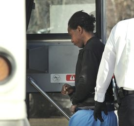 Lionel Brathwaite was led from the rear of the courthouse to a sheriff's transport bus on Tuesday.