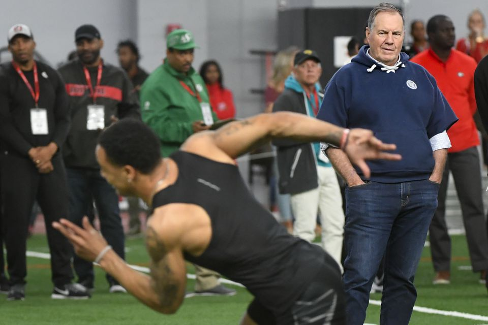 Bill Belichick watches a Georgia player during the school's Pro Day.